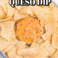 Chicken Queso Dip - It's meaty, creamy and tastes amazing on top of a tortilla chips. This queso dip is seriously addicting!