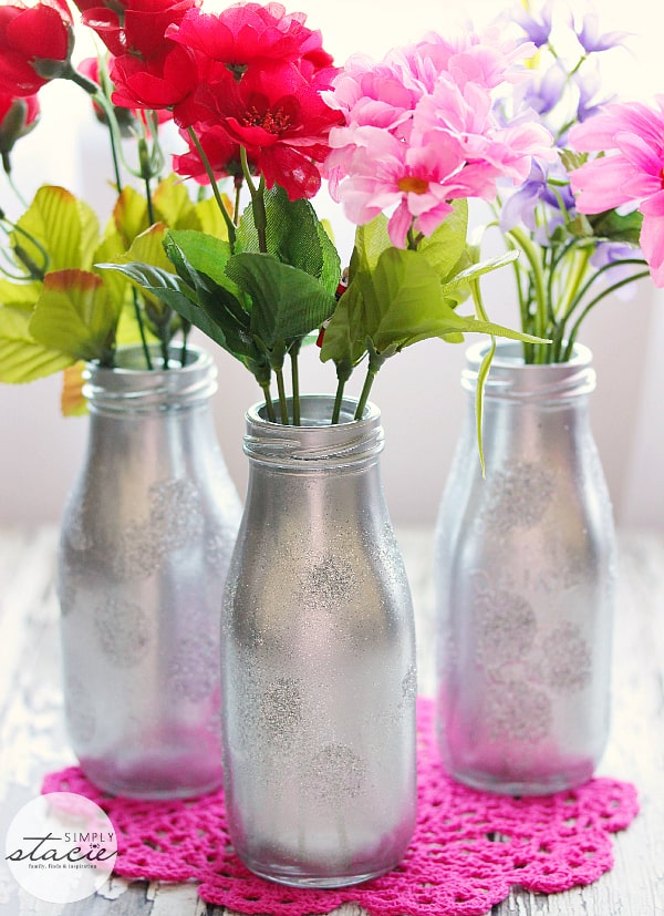 DIY Valentine's Day Vase - Get creative with your kids this Valentine's Day. These DIY Flower Vases are silvery and shiny—and the perfect complement to any winter floral arrangement. Grab your paint and get messy!