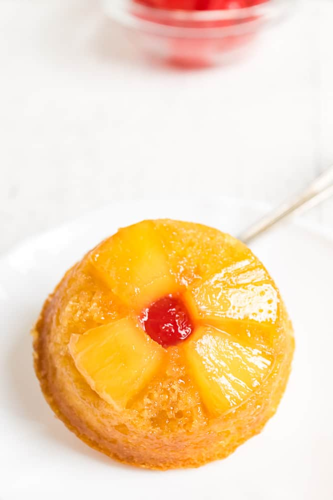 Pineapple Upside Down Cupcakes - These retro inspired cupcakes make things in the kitchen a little more convenient by using a yellow cake mix. They are moist, full of pineapple and caramel flavour and are so eye catching with the pineapple and cherry design!