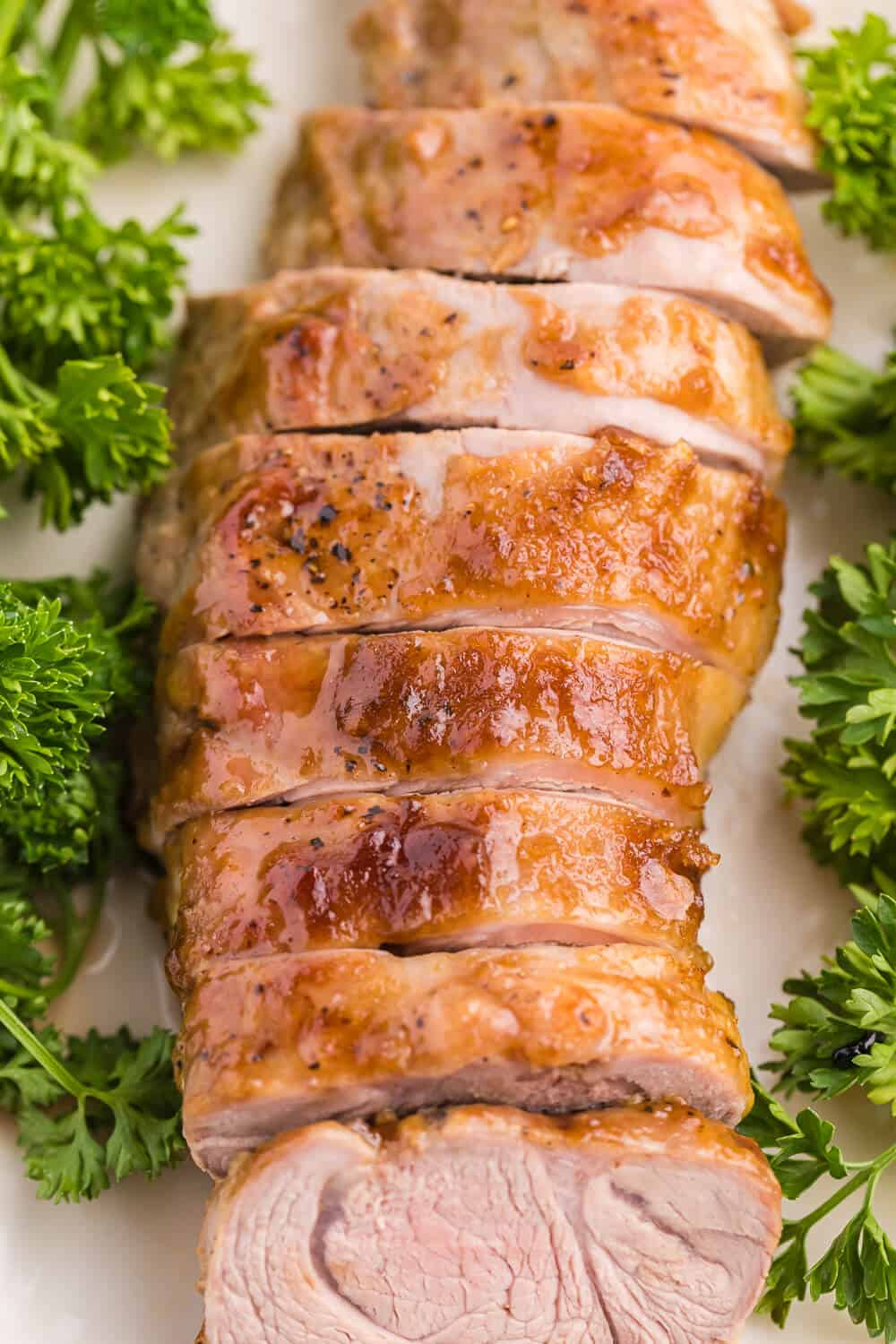 Brown Sugar Dijon Pork Tenderloin - Only two ingredients for this delicious dinner recipe! This sweet and savory glaze goes perfectly with the tender, juicy pork.
