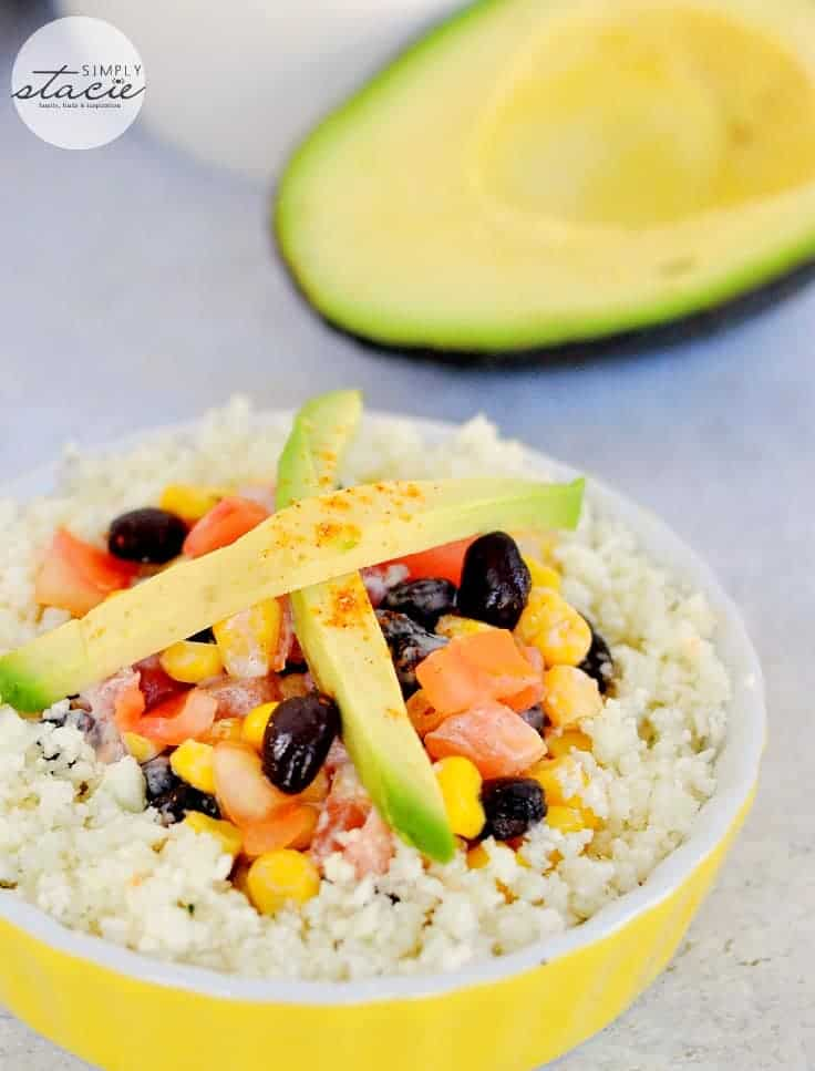 Cauliflower Rice Enchilada Bowl - The low-carb option for Taco Tuesday! This light vegetarian dish is made with cauliflower rice, corn, black beans, sour cream, and a little avocado on top.
