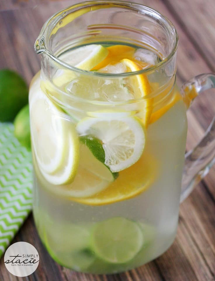 Citrus Bliss Infused Water - refreshing and easy! Cool down with a glass of cold water filled with lemon, lime and orange slices.