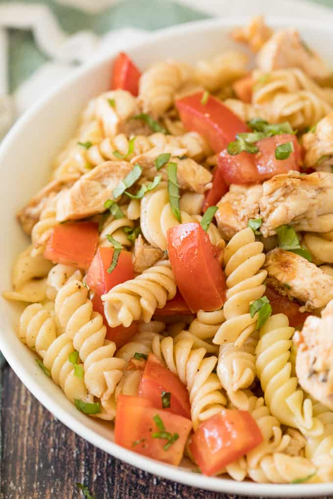 Bruschetta Chicken Pasta Salad - The best pasta salad! Add fresh tomatoes and basil for an amazing summer side dish packed with protein.