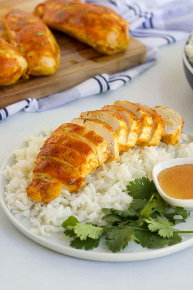 Honey Dijon Chicken - No dry chicken here! Take your juicy baked chicken breasts from basic to amazing with this sweet and savory marinade. Chicken breasts smothered in honey, Dijon mustard and spices and then baked to perfection!