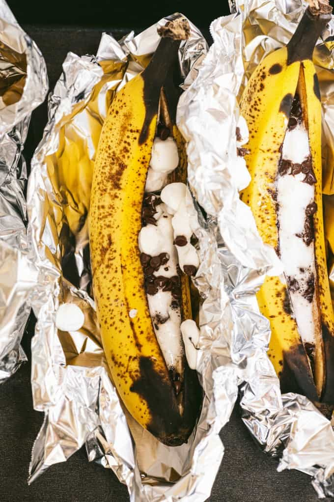 Banana Boats - The perfect camping dessert! Ripe bananas stuffed with gooey marshmallows and melty chocolate are always in season.