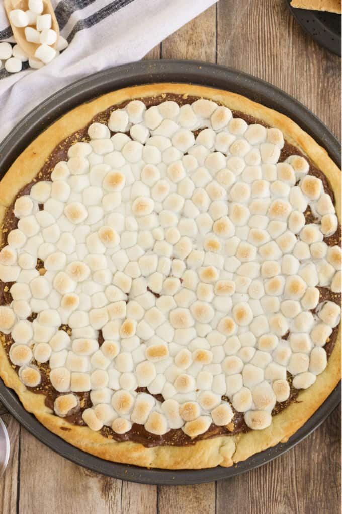 S'mores Pizza - S'mores indoors! Bring the camping to the oven with this graham cracker, chocolate, and marshmallow pizza for a great family night treat.