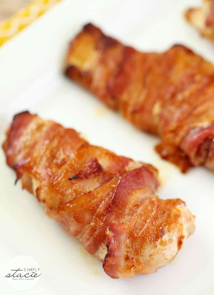 Bacon Wrapped Chicken - Only 4 ingredients! Juicy chicken breasts wrapped in crispy bacon and slathered with barbecue sauce and a little paprika.