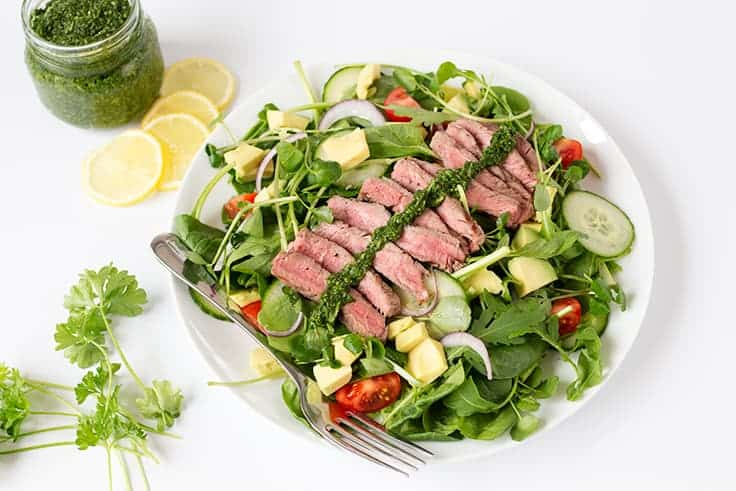 Chimichurri Steak Salad Recipe - A lighter version of your favorite steak dinner! This chumichurri recipe is so easy and goes great as a sauce or a dressing.
