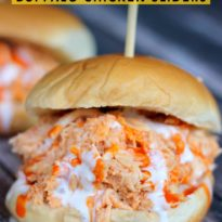 Slow Cooker Buffalo Chicken Sliders - The perfect game day appetizer. Tender, slow cooked chicken is enveloped in wing sauce and Ranch dressing and served on a soft slider bun. They are always a hit at parties!