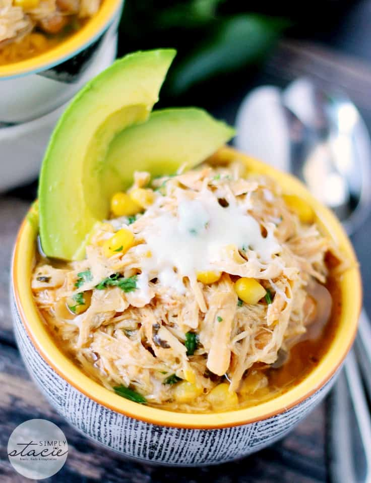 Slow Cooker Verde Chicken Chili Recipe - The best white chili recipe ever! Let the corn, cannellini beans, jalapeño, and yummy chicken simmer all day in the Crockpot for a perfect busy weeknight meal.