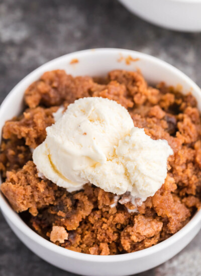Slow Cooker Pumpkin Dump Cake - This delicious fall dessert is quick and easy! The slow cooker can truly beat your oven for perfectly moist dump cakes.