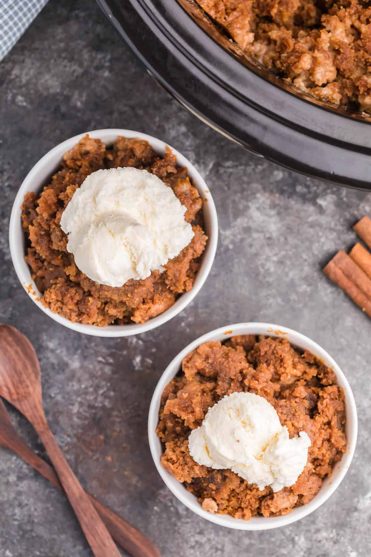 Slow Cooker Pumpkin Dump Cake - This is the easiest fall dessert! Your family will beg for this Crockpot dessert recipe made with boxed cake mix all year long.