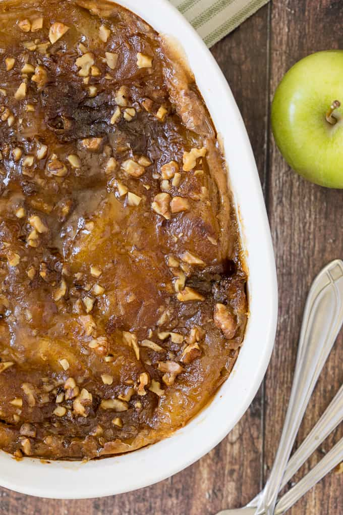 Apple Pie French Toast Casserole - A cross between apple pie and French toast, you will feel like you are eating dessert for breakfast....or breakfast for dessert! Chock full of delicious apples and cinnamon with a creamy, custardy bread layer, this is a satisfying beginning to the day, or end of a meal!