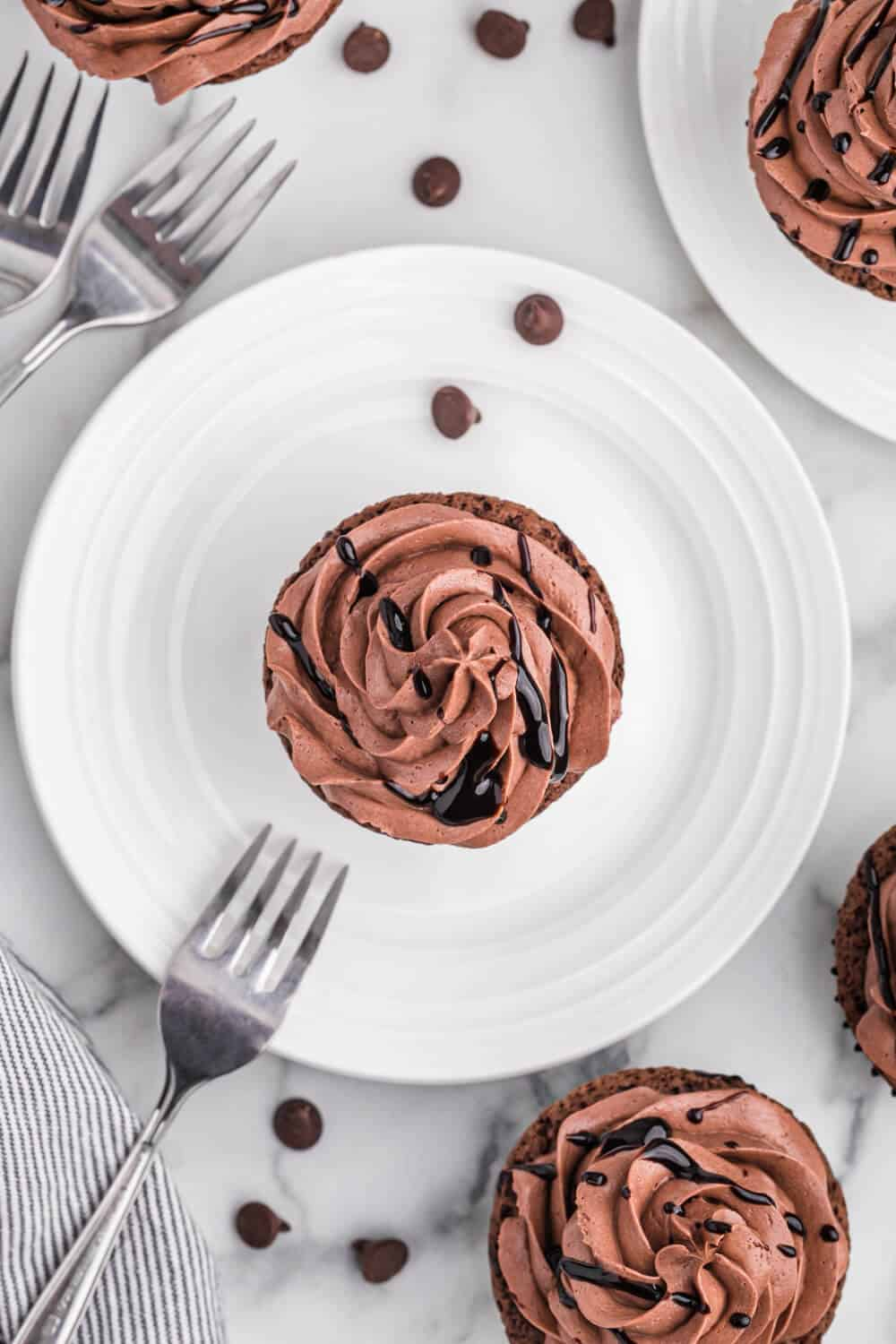 Death by Chocolate Cupcakes on a white plate with a fork