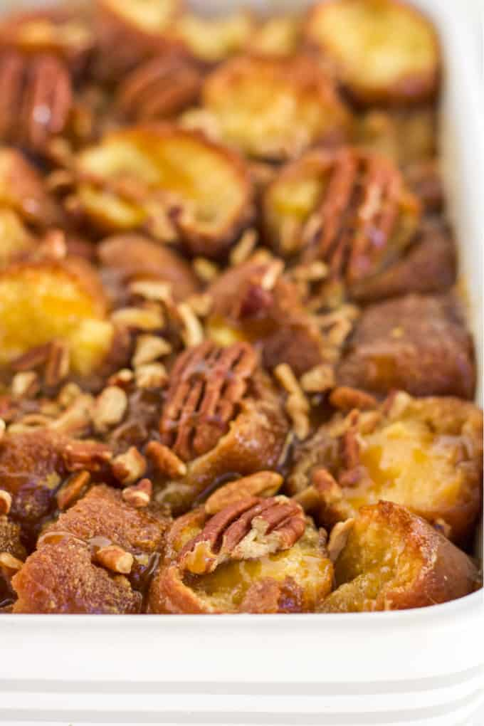 Caramel Pecan Breakfast Casserole - This is the ultimate breakfast casserole - the base is donuts! Combined with a sweet caramel and pecan topping, this easy recipe is a special occasion indulgence!