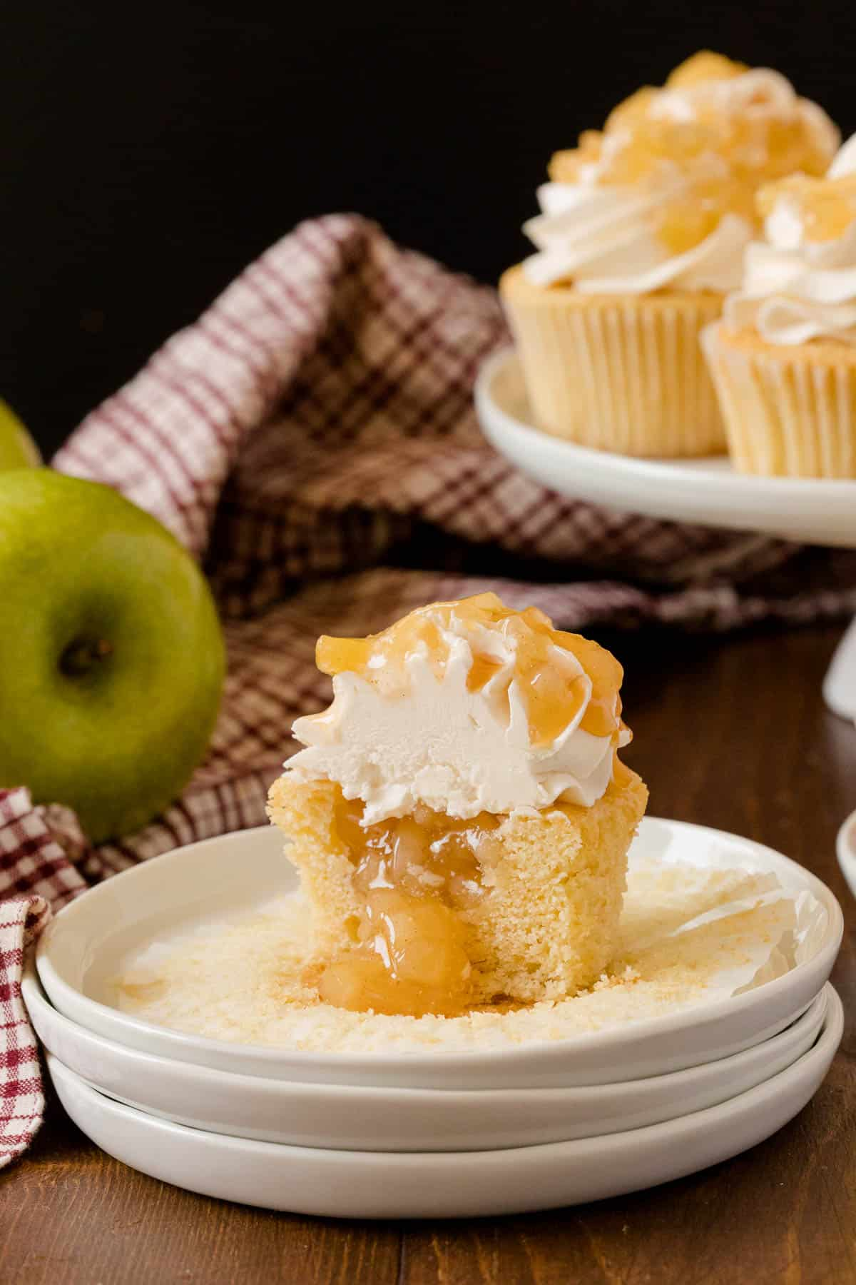 Caramel Apple Cupcakes - Fall in a cupcake! Sweet caramel and apple pie are packed into this delicious handheld dessert.