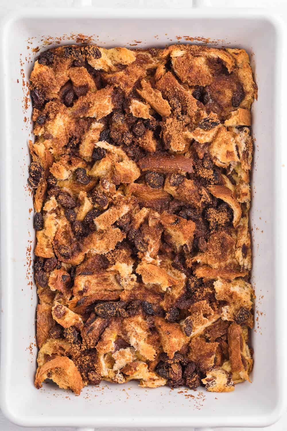 Cinnamon Raisin French Toast Casserole - Sweeten your mornings with this divine baked French Toast casserole recipe! It's bursting with raisins, cinnamon and yummy raisin bread.