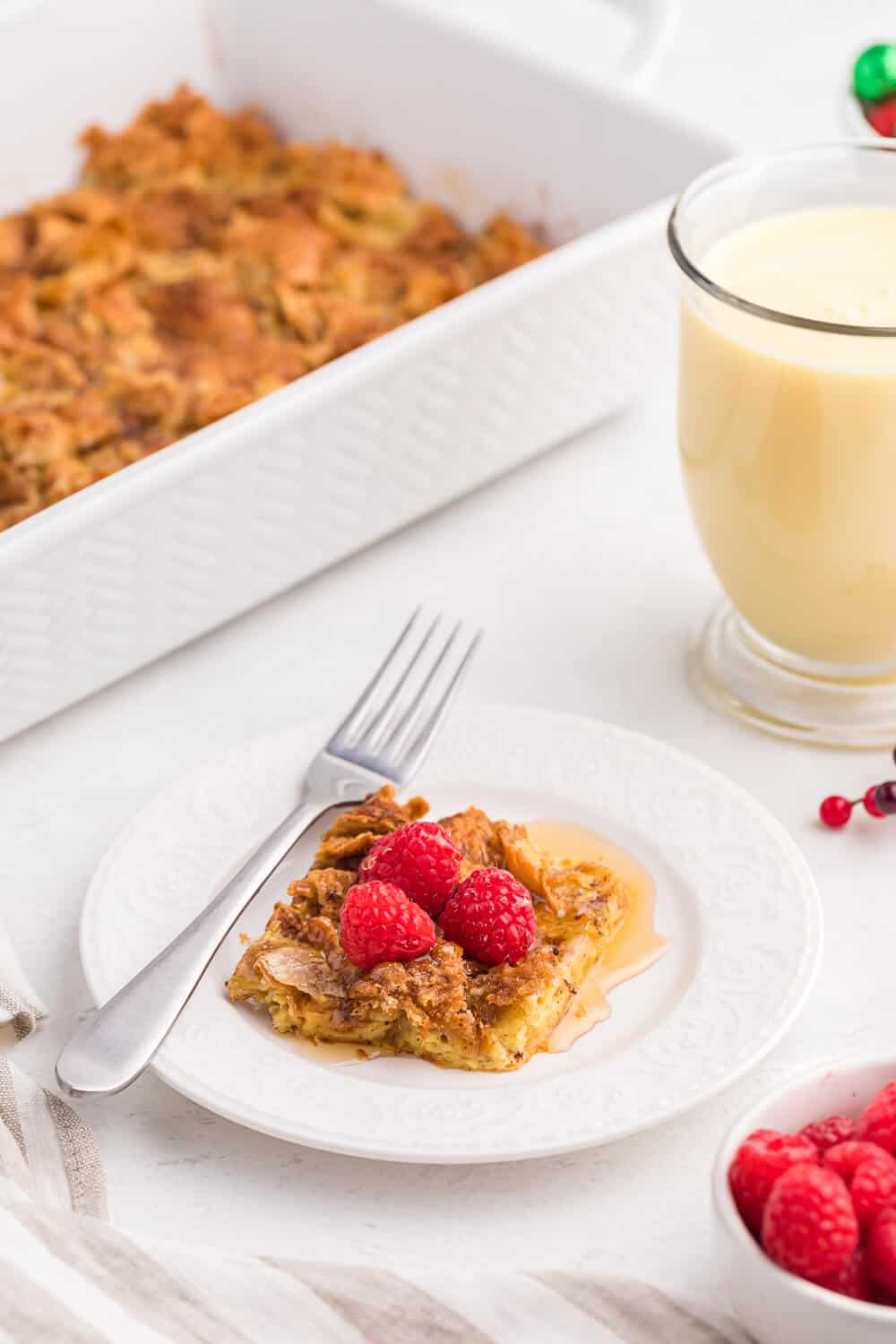 """Eggnog Breakfast Casserole - Nothing says """"holidays"""" like eggnog! This breakfast casserole is made extra special with a croissant base, a sprinkling of sweet brown sugar, cinnamon and nutmeg."""