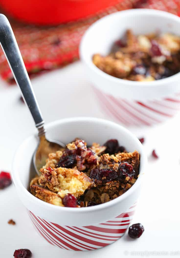 Cranberry Cobbler Dump Cake - This cake mix hack recipe is unbelievably delicious and easy! It's also a great way to use up leftover cranberry sauce.