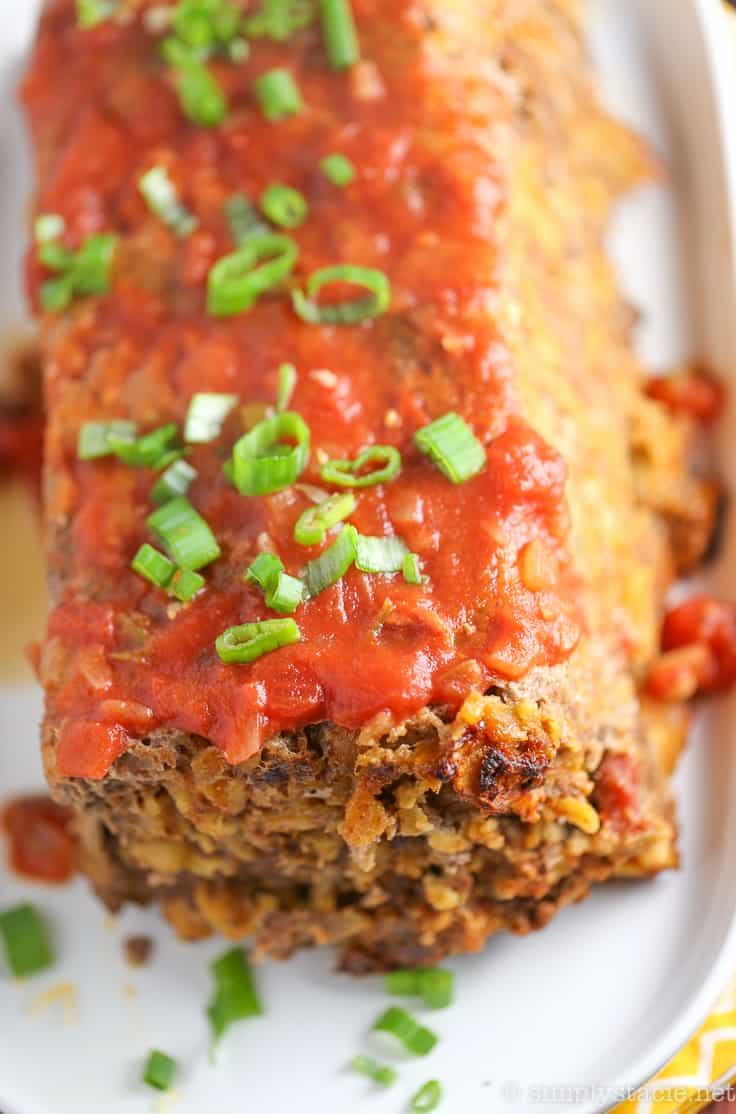 Mexican Meatloaf - A spicy twist on a classic recipe! This Mexican Meatloaf is packed with beef, cheese, seasonings, chilies and salsa. The results is a mouthwatering meal!