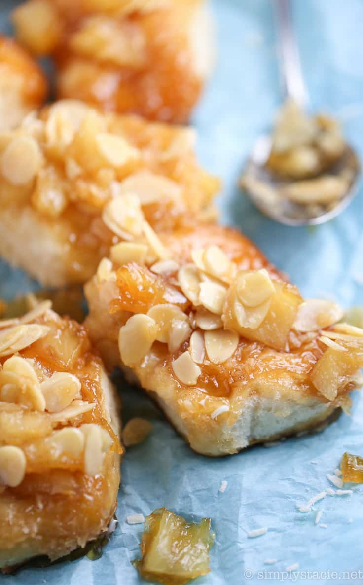 Pineapple Sticky Buns with Coconut Caramel - This ooey gooey dessert recipe is the bomb! It's easy to make and ready in 30 minutes. We couldn't stop eating them!