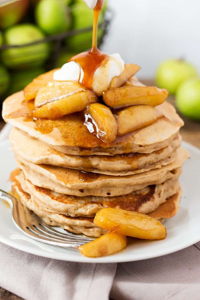 Apple Pie Pancakes - A spiced apple pancake recipe, topped with syrup poached apples and a spoonfuls of creamy, thick crème fraiche. This is one glorious breakfast!
