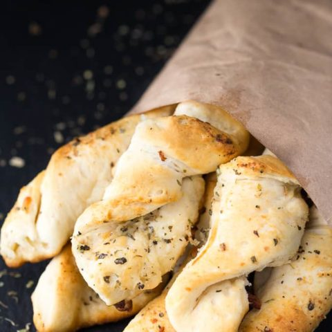 Easy Garlic Twists - This delicious recipe is a crowd favourite with only a few ingredients! Use refrigerated biscuits to save time.