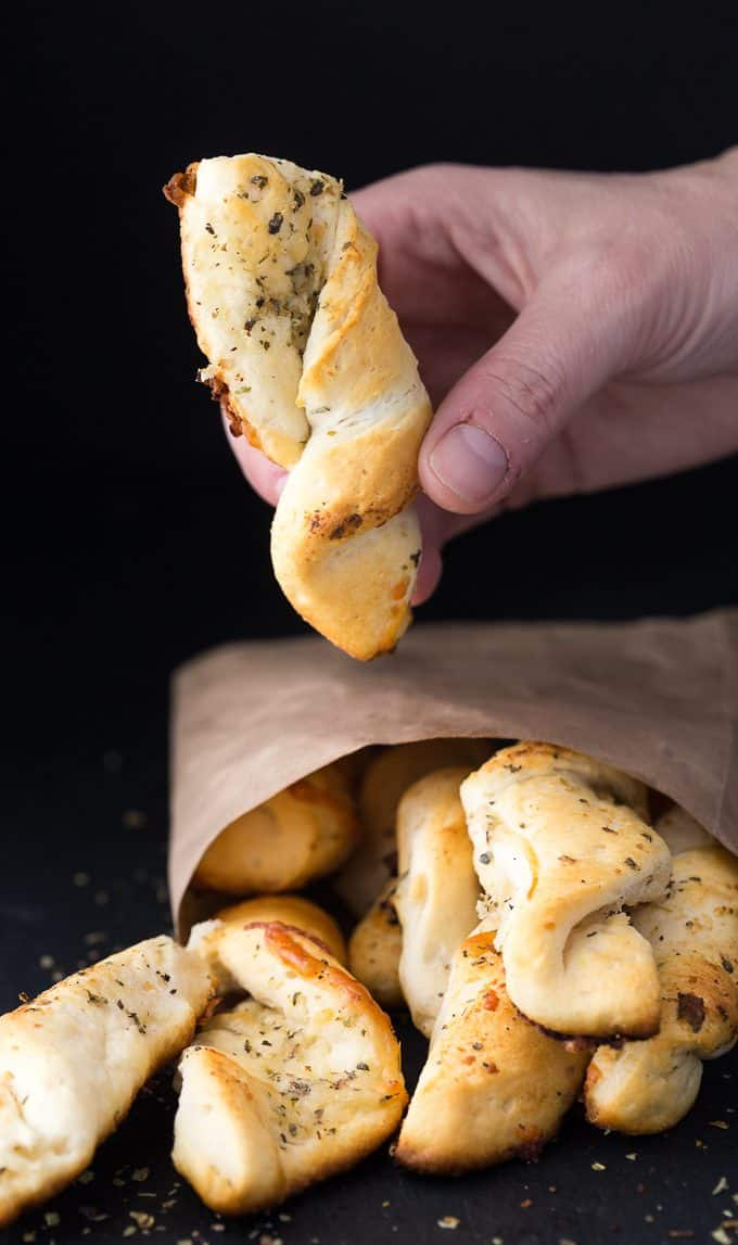 Easy Garlic Twists - The easiest garlic bread! Take those canned biscuits and make the best savory side dish with butter, Italian seasoning, Parmesan, and mozzarella.