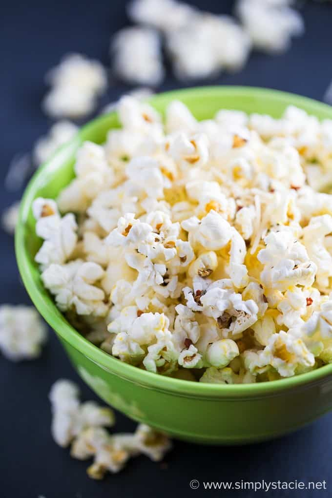Pizza Popcorn - perfect for movie night! Enjoy a big bowl of this spicy snack with NO greasy fingers. My family loves this recipe.