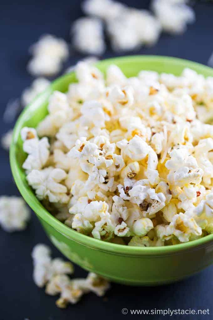 Pizza Popcorn - Perfect for movie night! Simple popcorn with Parmesan cheese, Italian seasoning, and red pepper flakes will be your new favorite savory snack.