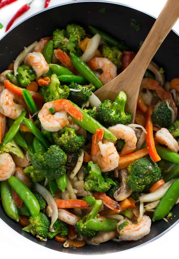 Chilli Coconut Shrimp Stir Fry - This stir fry recipe makes it easy to eat your veggies! Packed with shrimp, fresh veggies and a creamy, spicy Chilli Coconut sauce, each bite delights your taste buds and satisfies your hunger.