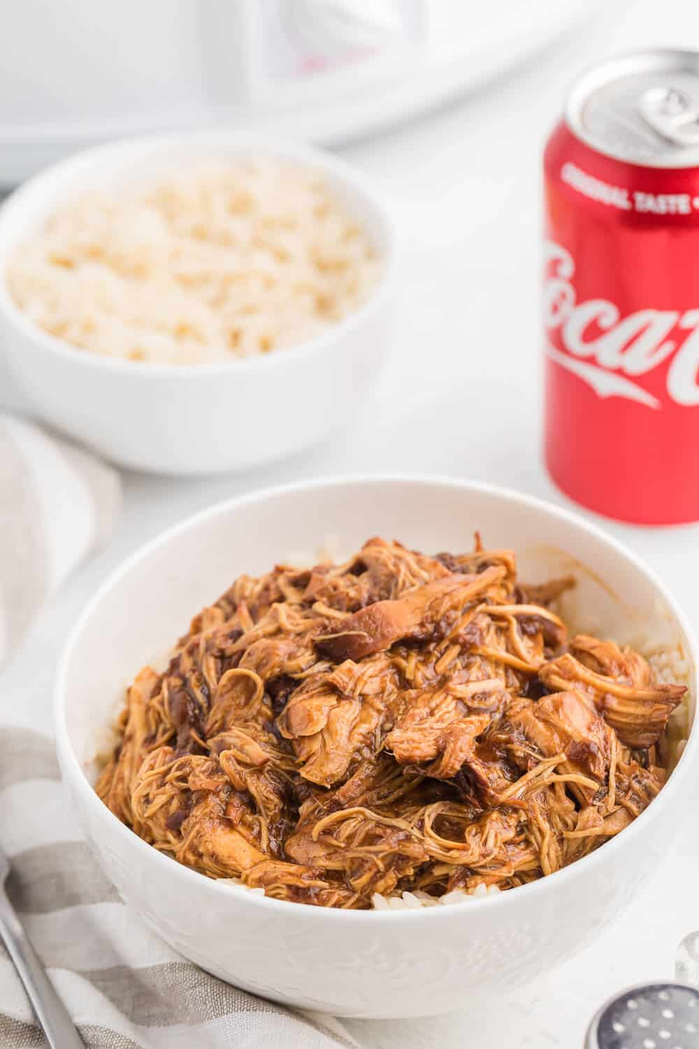 Cherry Coke Chicken - The easiest sweet and savory chicken recipe! Add some soda to your Crockpot for the most tender barbecue chicken breasts.