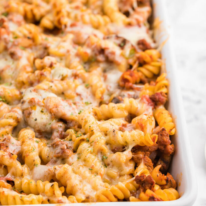 Meatzza Casserole - This crowd pleasing casserole recipe is packed with four kinds of meat, pizza sauce, veggies and oohey gooey cheese!