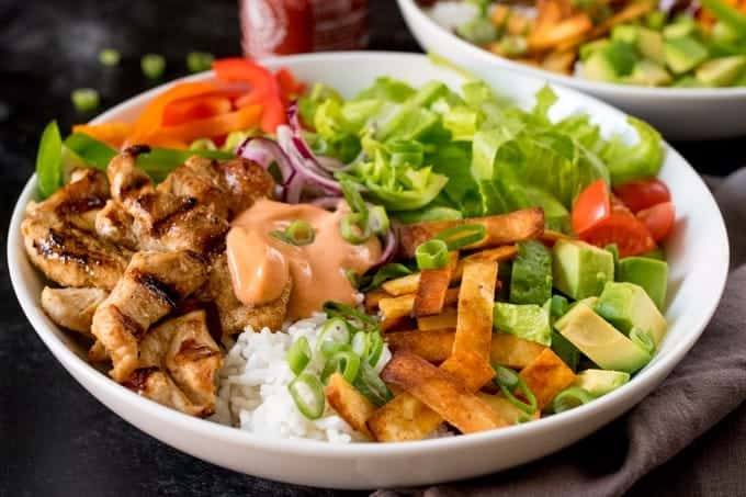 Tex Mex Lunch Bowl - A delicious and spicy salad with chicken, fresh veggies and a dressing that packs some heat!