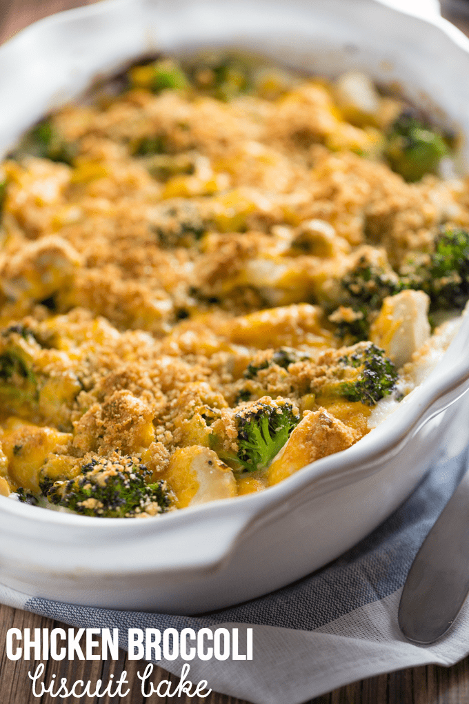 Chicken Broccoli Biscuit Bake - The ultimate comfort food! Country biscuits baked in a creamy Alfredo sauce and topped with broccoli, garlic onions and melted cheese. SO GOOD!