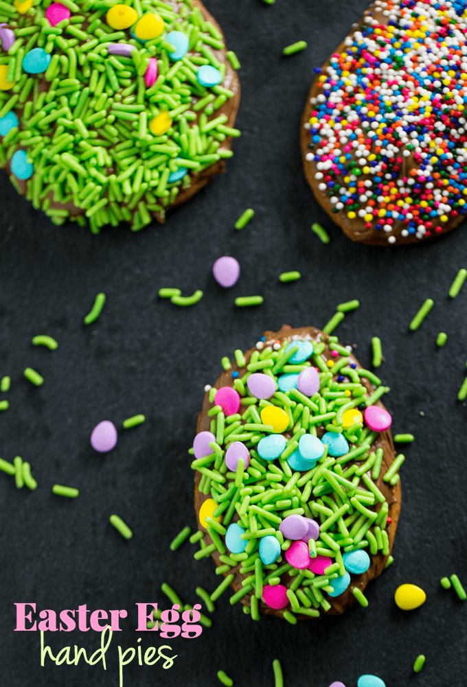 Easter Egg Hand Pies - Super easy Easter dessert made with refrigerated pie crust, melted chocolate and sprinkles! A fun Easter recipe for the kids to make.