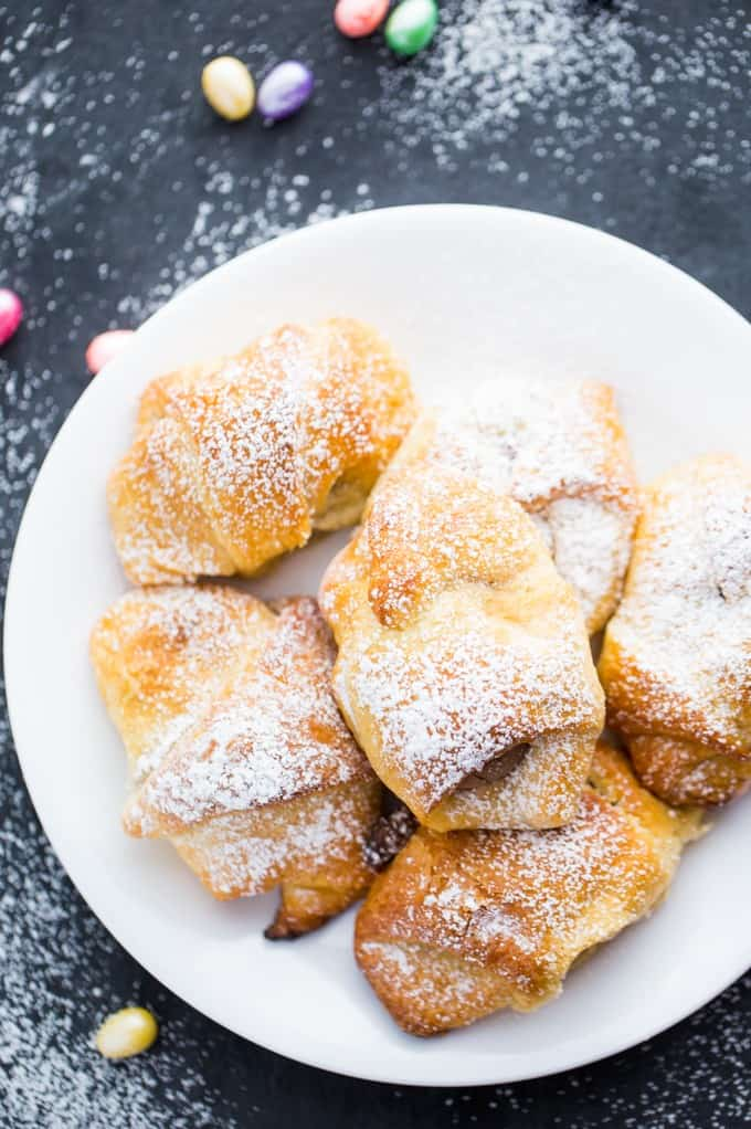 Easter Egg Stuffed Crescent Rolls - Chocolate for breakfast? Always! These delicious crescent rolls are made for Easter morning when the bunny brings too many chocolate eggs.