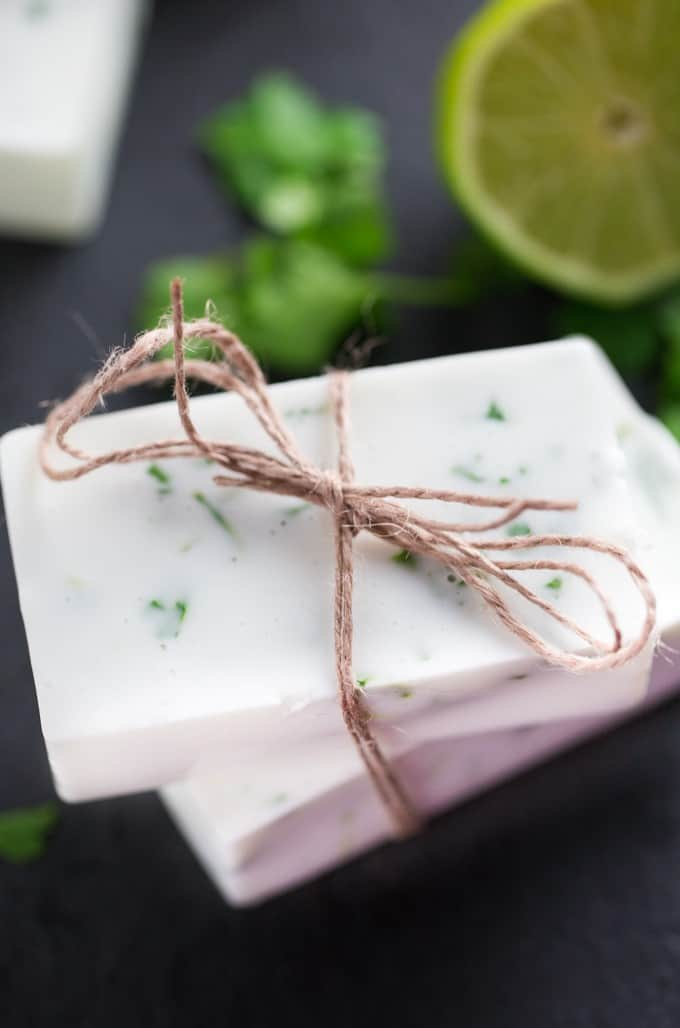 Lime Cilantro Soap - Don't let those fresh herbs go to waste! Make soap! This Lime Cilantro Soap is made with melt and pour shea butter soap base, lime essential oil and fresh cilantro.