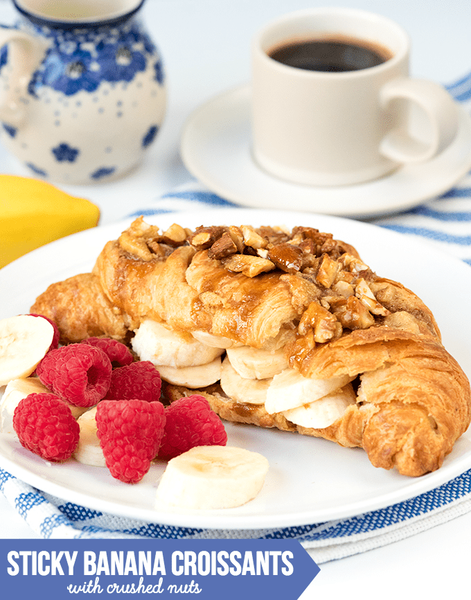 Sticky Banana Croissants with Crushed Nuts - Flaky croissants stuffed with bananas and brown sugar frangipane, then topped with honey-coated nuts. The best Sunday breakfast!