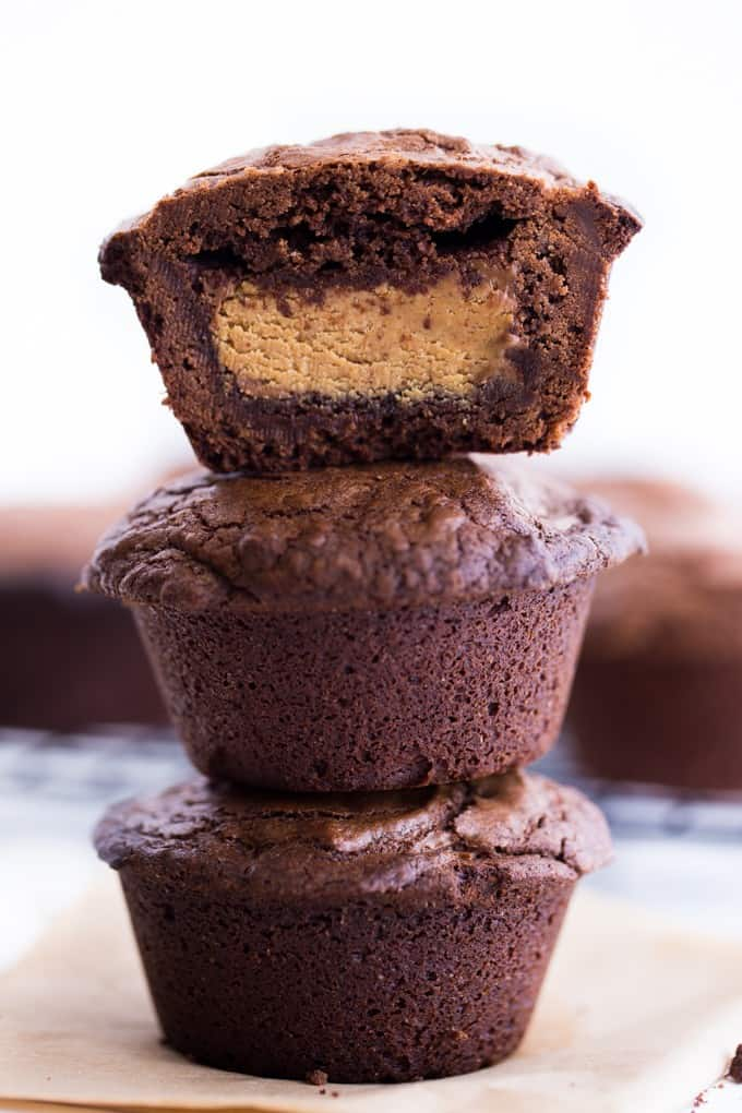 Reese's Stuffed Brownies - Giant Reese's Peanut Butter Cups are stuffed inside a rich chocolate brownie. Each bite is pure chocolate heaven!