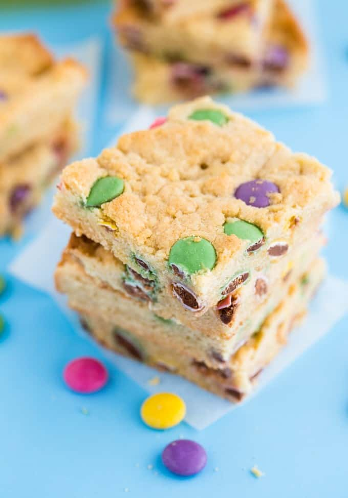 Smarties Blondies - Chewy and sweet bars dotted with delicious candy coated chocolate Smarties. You may want to double the batch because these are gone in a flash!
