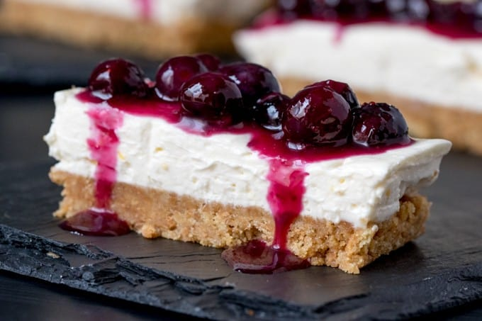 Blueberry & Lemon Cheesecake Bars - Packed full of YUM! Blueberry and lemon cannot be beat when it's paired with luscious cheesecake. Plus, this dessert is no-bake!