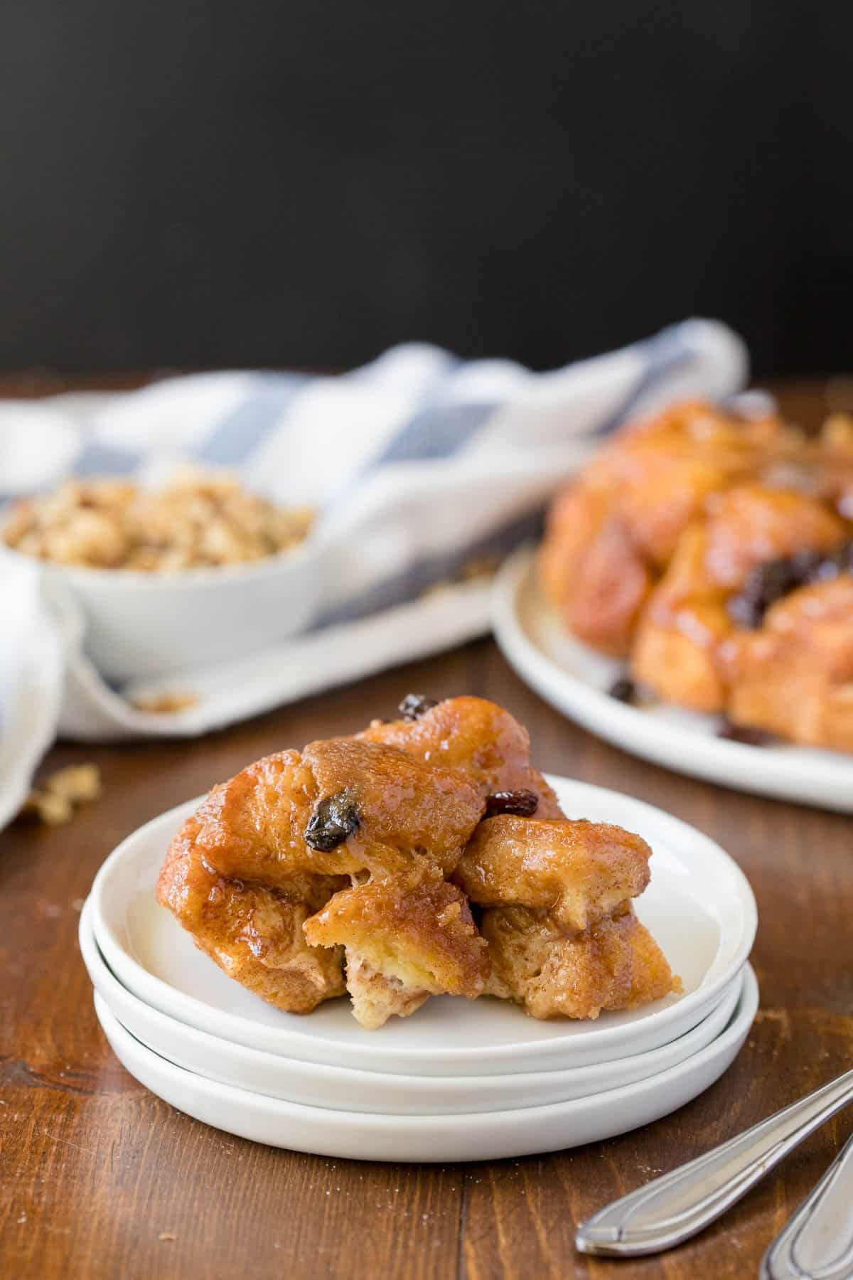 Classic Monkey Bread Recipe - Easy pull-apart bread swimming with walnuts, raisins, and a sweet glaze. Made for breakfast or dessert!