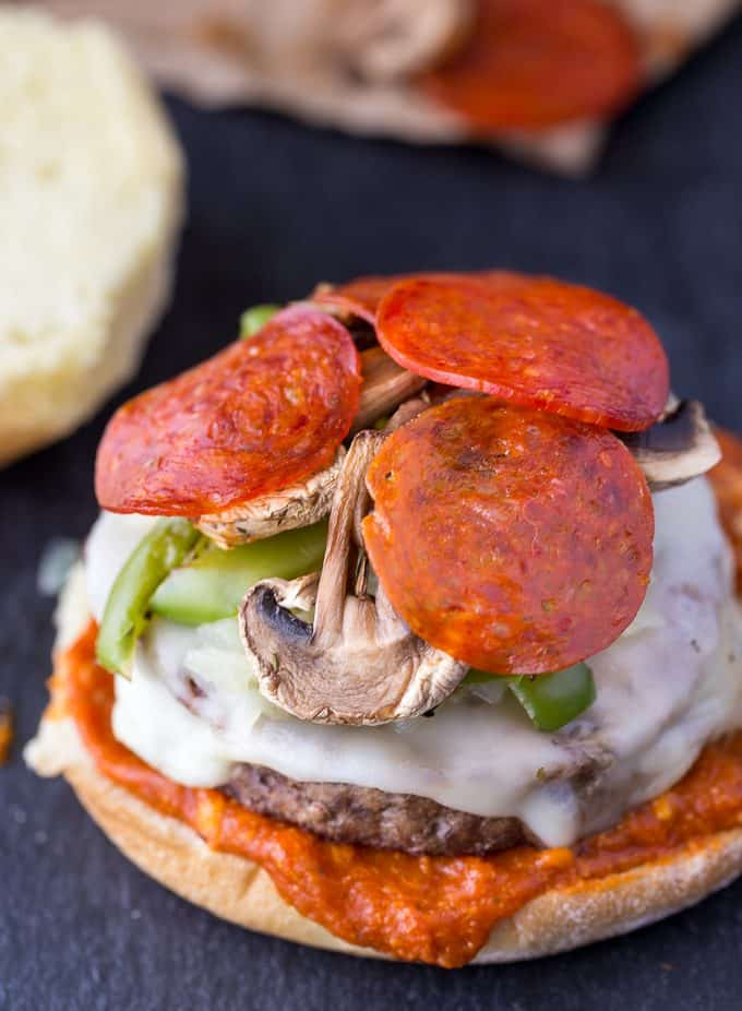 Deluxe Pizza Burgers - Loaded to the max with all your favourite pizza toppings. Take one bite and you'll see why my family raves about these delicious burgers!