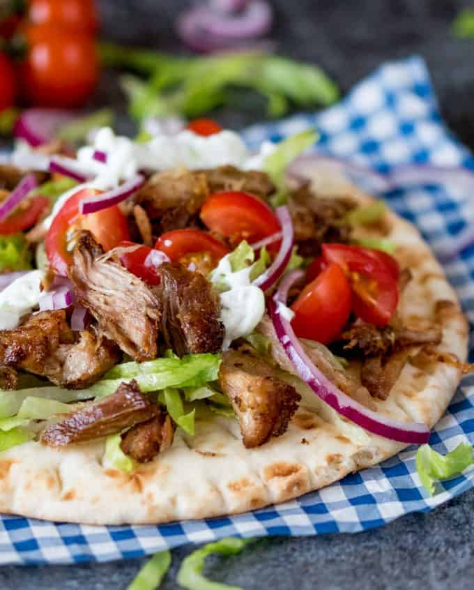 Pork Gyros with Tzatziki and Sweet Chili Sauce - This recipe for pork gyros is a keeper – one taste and you'll be hooked!