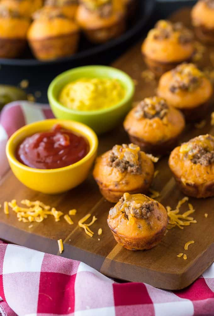 Cheeseburger Muffins - These tailgate treats are stuffed with your favorite burger toppings! Delicious dipped in ketchup and mustard.