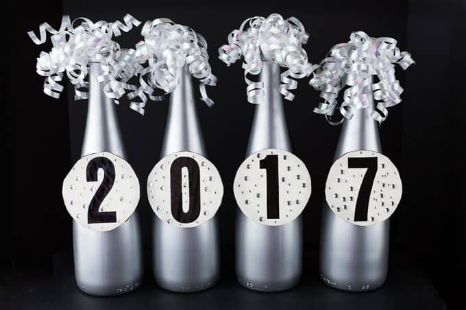 DIY New Year's Eve Bottle Centerpiece - Simple to make and looks so sharp. An easy way to add some flair to your New Year's party.