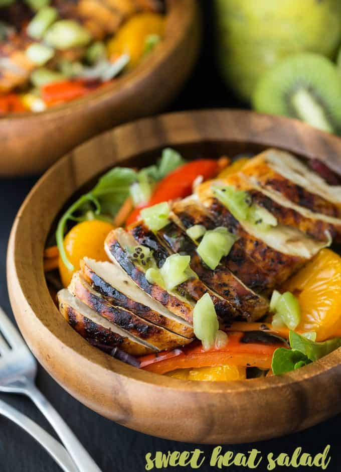 Sweet Heat Salad Recipe - Spicy and sweet meet for this dinner salad recipe! This Asian-inspired main dish is my take on the Swiss Chalet favorite with peppers, oranges, carrots, and a lime chili dressing.