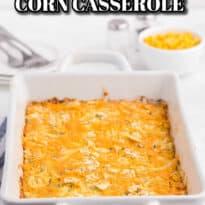 cheesy corn casserole in a white casserole pan