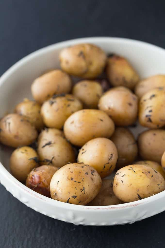 Savoury Slow Cooker Potatoes - Tender mini potatoes bursting with savoury flavour with every bite! This side dish is easy to make and well loved by all.